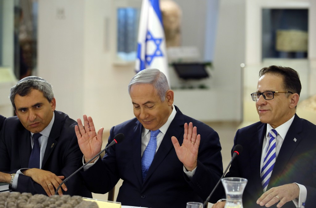 Israeli minister Zeev Elkin, left, is pictured with Prime Minister Benjamin Netanyahu and Cabinet secretary Tzachi Braverman in Jerusalem on 13 May 2018 (AFP)