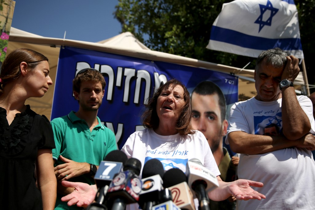 Zehava Shaul, mother of Oron Shaul, speaks to reporters (AFP)